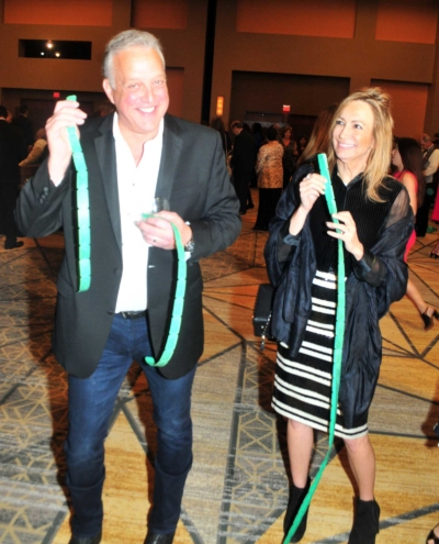 Couple with raffle tickets at the 2017 Kings & Queens of Good Hearts Fun-Raiser
