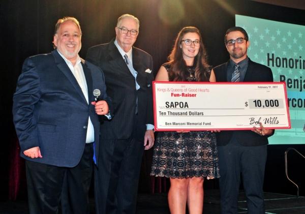 Bob Wills presenting a $10,000 check to SAPOA
