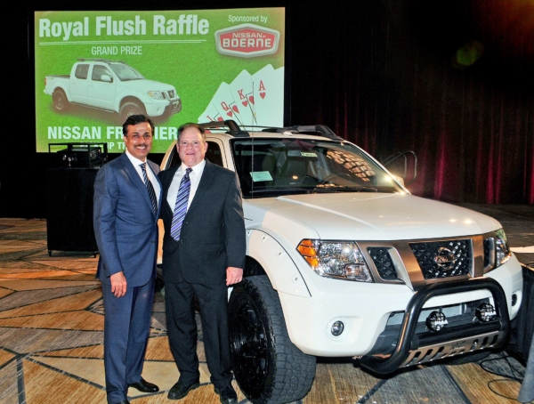 Nissan of Boerne's Mike & Umer with Frontier Truck