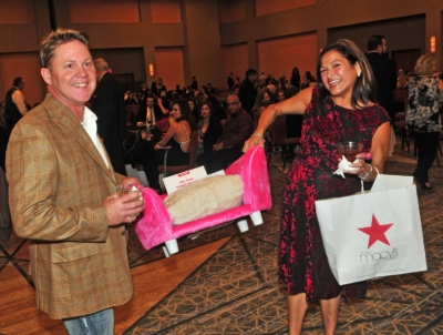couple with silent auction items